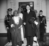 The Sultan of Muscat & Oman Said bin Taimur Bin Faisal, at the White House wiith Stanley Woodward, assistant chief of the Division of Protocol, State Department, 1938.<br/><br/>  Said bin Taimur (13 August 1910 – 19 October 1972) (Arabic: سعيد بن تيمور‎) was the sultan of Muscat and Oman (the country later renamed to Oman) from 10 February 1932 until his overthrow on 23 July 1970.